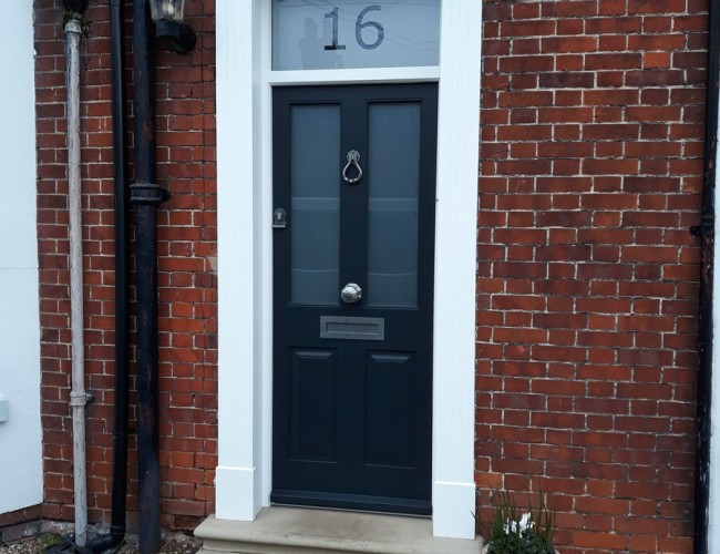 Entrance Door With Numbered Glass